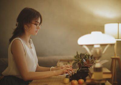 Woman Writer Working on a Typewriter