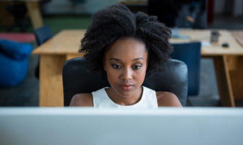 Female graphic designer using desktop pc
